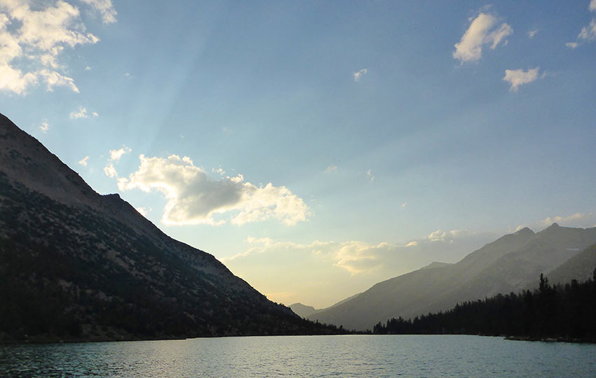 Charlotte Lake surrounded by mountains at sunset