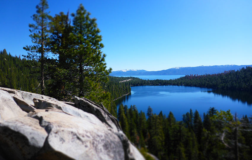 Cascade Lake and Lake Tahoe surrounded by trees