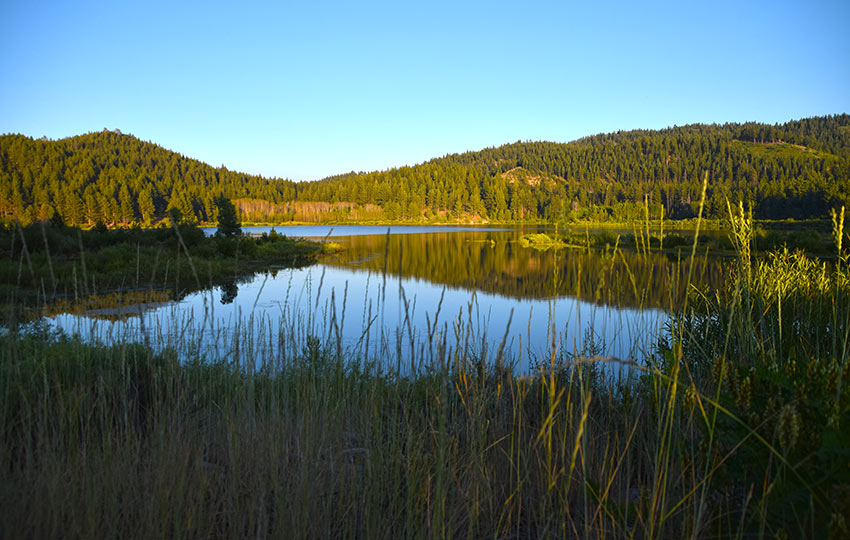 The sun setting on Spooner Lake during summer